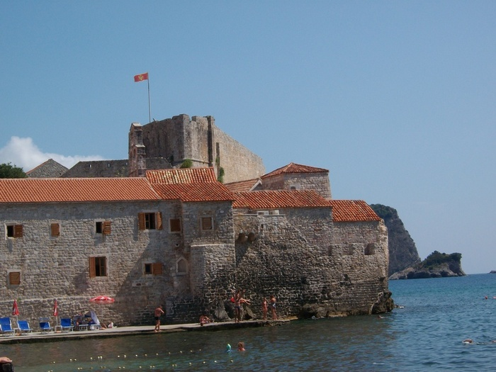 People frolicing in front of the walls of Budva, Montenegro